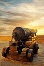 Antique cannon on nuclei at sunset Royalty Free Stock Photo