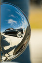 Antique car reflected on another antique car Stock Photography