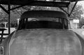 Antique car rusting away in an old barn Royalty Free Stock Photos