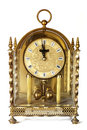 Antique carriage clock isolated gilded on white Stock Photos