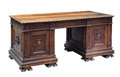 Antique carved mahogany writing desk Royalty Free Stock Photo