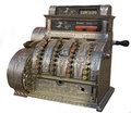 An antique cash register isolated on white. Royalty Free Stock Photo