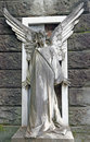 Antique cemetery angel on monumental cemetery Stock Photos