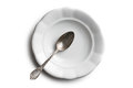 Antique ceramic plate and silver spoon Royalty Free Stock Photo