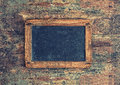 Antique chalkboard on wooden texture nostalgic background with copy space for your text retro style toned picture Royalty Free Stock Image
