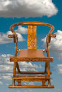 Antique chinese folding chair made in the th century isolated in sky with a zen float like feeling Stock Photography