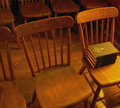 Antique church chairs with hymnals Royalty Free Stock Photo