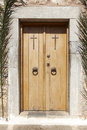 Antique church entrance wooden door with crosses. Crete. Greece Royalty Free Stock Photo
