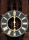 Antique church tower clock old with roman numerals on a Royalty Free Stock Photo