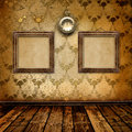 Antique clock face and frames on the wall Royalty Free Stock Photos