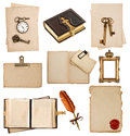 Antique clock key postcard photo album feather pen old paper sheets with vintage accessories isolated on white background Royalty Free Stock Images