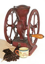 Antique coffee wheel grinder, beans, cup Stock Image