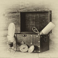 Antique compass, inkwell and old wooden chest on wooden table. black and white style old photo Royalty Free Stock Photo