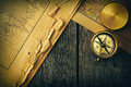 Antique compass over old map Royalty Free Stock Photo