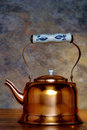 Antique Copper Boiling Kettle with Ceramic Handle Stock Photo