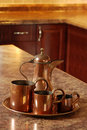 Antique copper set focus on jug Royalty Free Stock Photo