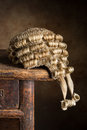 Antique court wig made of horsehair lying on an old desk Stock Images