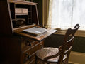 Antique desk and chair study in an historic residence Royalty Free Stock Image