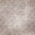 Antique diamond pattern an with flourish Stock Images