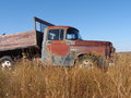 Antique dodge one ton truck in prairie field Royalty Free Stock Photography