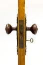 Antique door and door handle with skeleton key in Royalty Free Stock Photo
