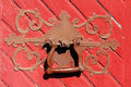 Antique door handle close up of an ornate on a red wooden Royalty Free Stock Photo
