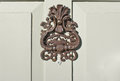 Antique door knocker close up of an on a front Stock Image