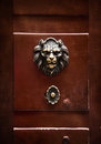 Antique door knocker in the form of a lion s head on old door r wooden rome italy Stock Photos