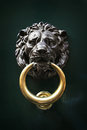 Antique door knocker in the form of a lion s head rome italy on old wooden Royalty Free Stock Images
