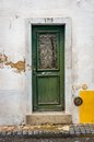 Antique door old in the city of lisbon portugal Royalty Free Stock Photos