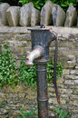 Antique English water pump Royalty Free Stock Photo