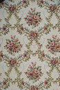 Antique fabric picture of an with floral pattern Royalty Free Stock Image