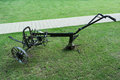 Antique farming plough old fashined plow for agriculture on green grass Stock Photo