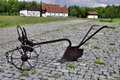 Antique farming plough a rusting old fashioned plow for agriculture Royalty Free Stock Photography