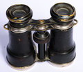 Antique field glasses on the white background Stock Image
