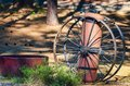 Antique Fire Extinguisher and Wagon Wheels Royalty Free Stock Photo