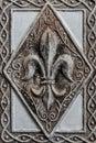 Antique Fleur-de-lis on Tile Royalty Free Stock Photo