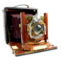 Antique folding camera front view an old isolated on a white background Stock Photo
