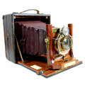 Antique folding camera side view an old isolated on a white background Stock Photography