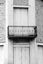 Antique french architecture iron balcony a photograph showing the wrought design on an old stone house in the south of france Stock Photography