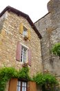 Antique french medieval house a photograph showing the beautiful and quaint architecture of an mediaeval located in puy l eveque Royalty Free Stock Image