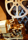 Antique gold color projector with the film Stock Image