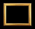 The antique gold frame on black background. Royalty Free Stock Photo