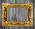 Antique gold frame on white wooden wall Royalty Free Stock Photo