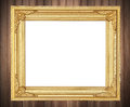 Antique gold frame on wooden wall Royalty Free Stock Photo