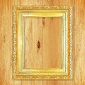 Antique gold frame on wooden wall;. Empty picture frame on woode Royalty Free Stock Photo
