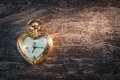 Antique gold pocket watch in the form of heart. Stock Photography