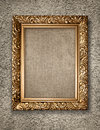 Antique golden frame on rustical wall with canwas Stock Images