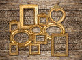 Antique golden framework rustic wooden wall Royalty Free Stock Photo