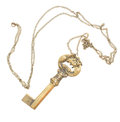 Antique golden skeleton key with chain isolated on white background Royalty Free Stock Photos
